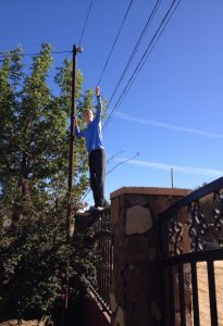 Micah holding power line